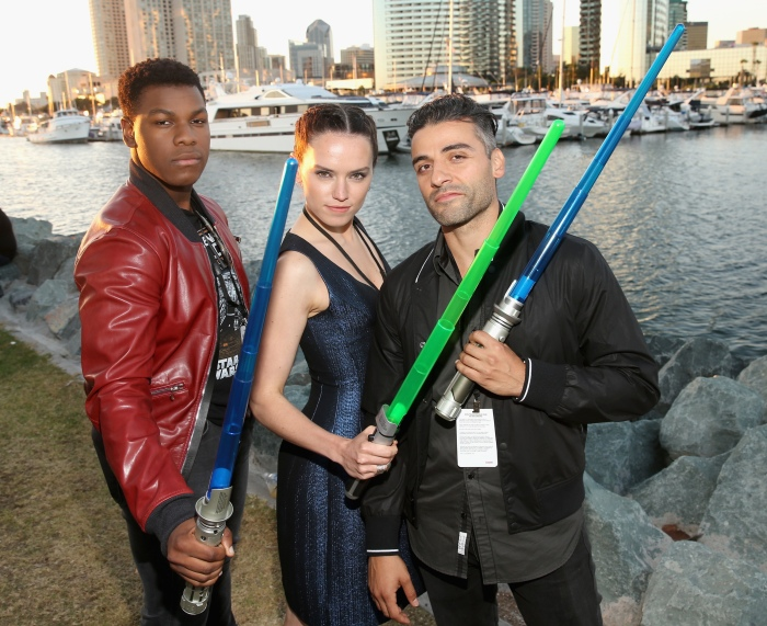 """SAN DIEGO, CA - JULY 10: (L-R) Actors John Boyega, Daisy Ridley, Oscar Isaac and more than 6000 fans enjoyed a surprise """"Star Wars"""" Fan Concert performed by the San Diego Symphony,  featuring the classic """"Star Wars"""" music of composer John Williams, at the Embarcadero Marina Park South on July 10, 2015 in San Diego, California.  (Photo by Jesse Grant/Getty Images for Disney) *** Local Caption *** Oscar Isaac; John Boyega; Daisy Ridley"""