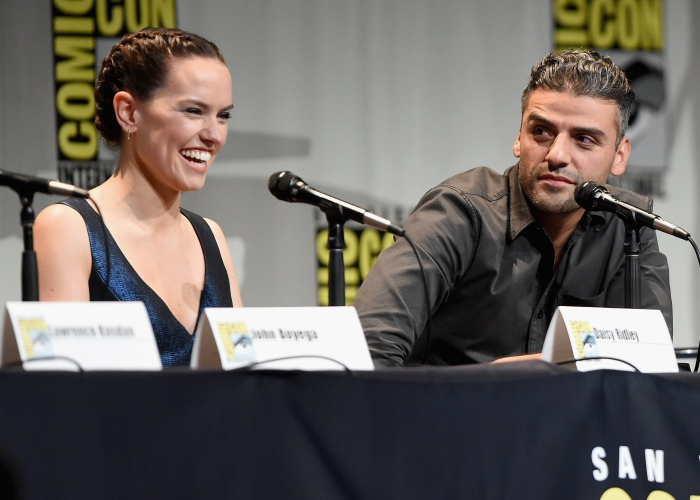 """SAN DIEGO, CA - JULY 10:  Actors Daisy Ridley (L) and Oscar Isaac at the Hall H Panel for """"Star Wars: The Force Awakens"""" during Comic-Con International 2015 at the San Diego Convention Center on July 10, 2015 in San Diego, California.  (Photo by Michael Buckner/Getty Images for Disney) *** Local Caption *** Daisy Ridley; Oscar Isaac"""