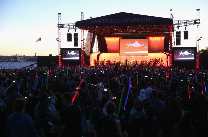 """SAN DIEGO, CA - JULY 10:  Following the """"Star Wars"""" Hall H presentation at Comic-Con International 2015 at the San Diego Convention Center in San Diego, Calif., the audience of more than 6000 fans enjoyed a surprise """"Star Wars"""" Fan Concert performed by the San Diego Symphony, featuring the classic """"Star Wars"""" music of composer John Williams, at the Embarcadero Marina Park South on July 10, 2015 in San Diego, California.  (Photo by Jesse Grant/Getty Images for Disney)"""