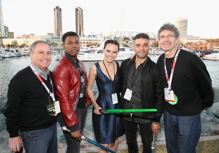 """SAN DIEGO, CA - JULY 10:  (L-R) President, The Walt Disney Studios, Alan Bergman, actors John Boyega, Daisy Ridley, Oscar Isaac, Chairman, The Walt Disney Studios, Alan Horn and more than 6000 fans enjoyed a surprise """"Star Wars"""" Fan Concert performed by the San Diego Symphony, featuring the classic """"Star Wars"""" music of composer John Williams, at the Embarcadero Marina Park South on July 10, 2015 in San Diego, California.  (Photo by Jesse Grant/Getty Images for Disney) *** Local Caption *** Alan Bergman; Oscar Isaac; John Boyega; Daisy Ridley; Alan Horn"""