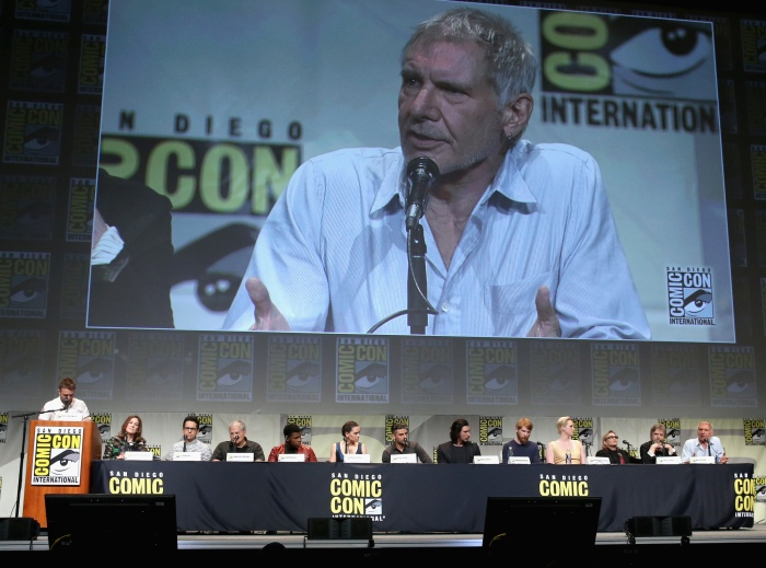 SAN DIEGO, CA - JULY 10:  (L-R) Moderator Chris Hardwick, producer Kathleen Kennedy, director J.J. Abrams, screenwriter Lawrence Kasdan and actors John Boyega, Daisy Ridley, Oscar Isaac, Adam Driver, Domhnall Gleeson, Gwendoline Christie, Carrie Fisher, Mark Hamill and Harrison Ford at the Hall H Panel for `Star Wars: The Force Awakens` during Comic-Con International 2015 at the San Diego Convention Center on July 10, 2015 in San Diego, California.  (Photo by Jesse Grant/Getty Images for Disney) *** Local Caption *** Chris Hardwick; Kathleen Kennedy; J.J. Abrams; Lawrence Kasdan; John Boyega; Daisy Ridley; Oscar Isaac; Adam Driver; Domhnall Gleeson; Gwendoline Christie; Carrie Fisher; Mark Hamill; Harrison Ford