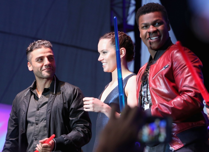 """SAN DIEGO, CA - JULY 10:  (L-R) Actors Oscar Isaac, Daisy Ridley, John Boyge and more than 6000 fans enjoyed a surprise """"Star Wars"""" Fan Concert performed by the San Diego Symphony, featuring the classic """"Star Wars"""" music of composer John Williams, at the Embarcadero Marina Park South on July 10, 2015 in San Diego, California.  (Photo by Jesse Grant/Getty Images for Disney) *** Local Caption *** Oscar Isaac; Daisy Ridley; John Boyega"""