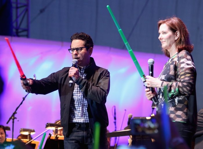 """SAN DIEGO, CA - JULY 10: Director J.J. Abrams (L), producer Kathleen Kennedy and more than 6000 fans enjoyed a surprise """"Star Wars"""" Fan Concert performed by the San Diego Symphony, featuring the classic """"Star Wars"""" music of composer John Williams, at the Embarcadero Marina Park South on July 10, 2015 in San Diego, California.  (Photo by Jesse Grant/Getty Images for Disney) *** Local Caption *** J.J. Abrams; Kathleen Kennedy"""