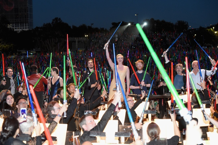 """SAN DIEGO, CA - JULY 10:  (L-R) Producer Kathleen Kennedy, director J.J. Abrams, actors John Boyega, Daisy Ridley, Oscar Isaac, Gwendoline Christie, Domhnall Gleeson, Carrie Fisher, Mark Hamill, Harrison Ford and more than 6000 fans enjoyed a surprise """"Star Wars"""" Fan Concert performed by the San Diego Symphony, featuring the classic """"Star Wars"""" music of composer John Williams, at the Embarcadero Marina Park South on July 10, 2015 in San Diego, California.  (Photo by Michael Buckner/Getty Images for Disney) *** Local Caption *** Harrison Ford; Mark Hamill; Carrie Fisher; Domhnall Gleeson; Gwendoline Christie; Adam Driver; Oscar Isaac; Daisy Ridley; John Boyega; J.J. Abrams; Kathleen Kennedy"""